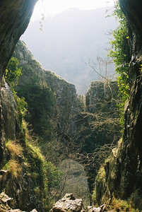 View through a rock arch in Dovedale. Notice that there's a second rock arch a little further down.