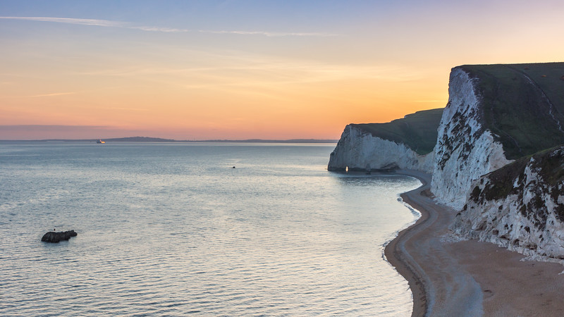 Durdle Door cliffs at Sunset