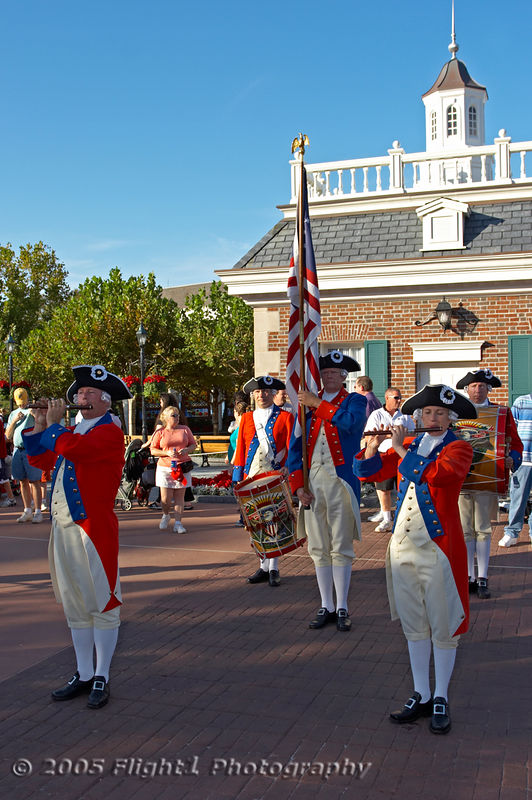 The Spirit of America Fife and Drum Corps performs for the crowd in front of Epcot's American Pavillion