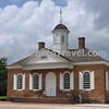 Colonial Williamsburg: Courthouse: Central to the life of the community in colonial times. The Declaration of Independence and Treaty of Paris (ending the Revolutionary war) was read from its steps! Here were heard debt, livestock and ownership disputes as well as crimes such as theft. Punishment was quick; the whipping post and the public stocks stood just outside, a few steps from the prisoner's dock. Serious cases involving free subjects (ones for which the penalty touched life or limb) were the province of the General Court, which met each April and October in the Capitol.