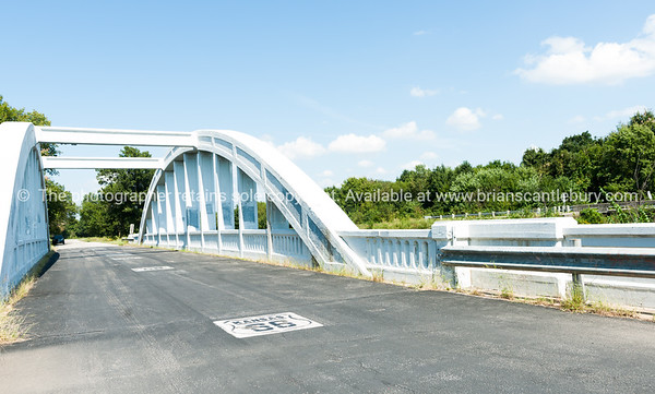 White concrete arch Bush Creek Bridge, Kansas, also known as Rainbow Bridge on historic Route 66, USA.