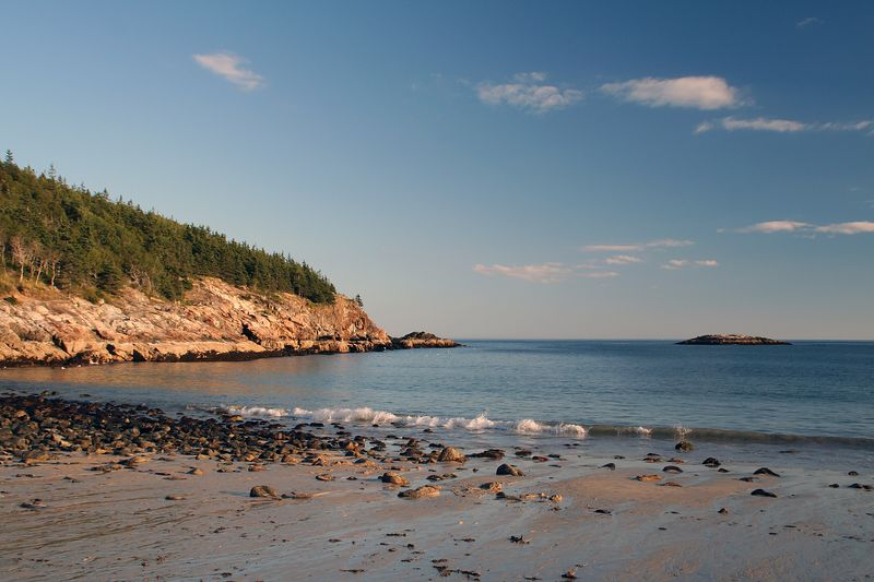 Sand Beac his a gorgeous little beach (290 yards long) nesteled between mountains and rocky shores.