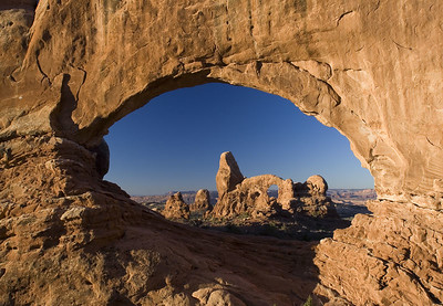 Arches National Park (North Window): Once water, ice and snow went to work on the rock, deepening and widening joints, all manner of oddly carved stones gradually emerged.