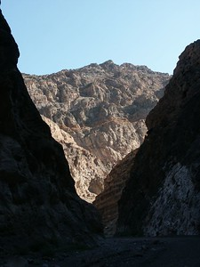 In Titus Canyon, gray and white cliffs, red and green hills, and fractured and contorted rocks point to the tremendous geologic forces that shaped the land comprising Death Valley National Park.
