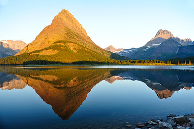 Great reflections of Mount Grinnell and Mount Wilbur in Swiftcurrent Lake.