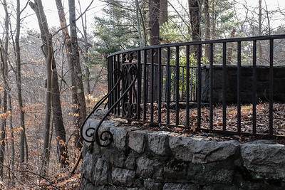 Wrought iron fence on old foundation.