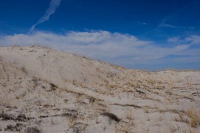 Up and over an almost barren dune.
