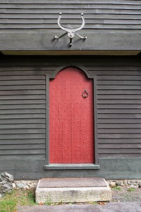 Red - thought to be original color of entry door.
