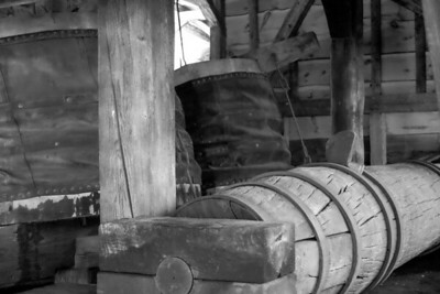 The shaft bringing in power for the bellows from the waterwheel.