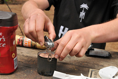 Sebastian´s breakfast 2 - no fork, therefore the corkscrew has to serve as tool to extract sausages out of can