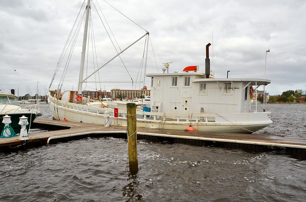 New Bern, North Carolina The Chesapeake buy boat, O.A. Bloxom, seen in New Bern, North Carolina, 5 November 2011.<br /><br />See more at:<br /><br />http://jacksonville.com/tu-online/stories/052408/met_282310730.shtml<br /><br />and from national Fisherman:<br /><br />Small marine railways that serve commercial fishermen are scattered up and down the southern portion of the United States. They are an important part of the infrastructure that keeps fishing boats afloat and the business of catching fish alive.<br /><br />Linton Marine Railway in Valona, Ga., is a good example. It is at the end of an old dirt road that leads down to shrimp boat docks. With a single railway, Linton caters to the longtime shrimping fleet that works out of Valona and other small fishing villages on the Georgia coast.<br /><br />Matt Linton, who owns and operates Linton Marine Railway, says his main customers are commercial fishermen. ?Mainly all we work on are commercial fishing boats or fishing boats that have taken on a new life,? he says. ?We are mostly a wooden-boat boatyard.?<br /><br />One older commercial fishing boat that has taken on a new life was on the railway in March getting its wooden hull covered with fiberglass.<br /><br />The O.A. Bloxom was built in 1901 and originally named the Nora Phillips. J.T. Marsh built the 75' x 21' O.A. Bloxom at his boatyard at Solomons, Md. The boat is historically significant because it is one of just a few Chesapeake Bay bugeyes still afloat.<br /><br />In the late 1800s and early 1900s, these sail-powered boats were used to dredge for oysters, serve as buyboats and haul freight on the bay. Most were built out of logs instead of planks. However, the O.A. Bloxom was built with planks ? pine planks, 3 inches thick. After being converted to power, the O.A. Bloxom worked Chesapeake Bay until 1991, when she went south to carry freight from Ft. Lauderdale, Fla., to the Caribbean.<br /><br />Ritch McCormack of Fernandina Beach, Fla., the boat?s ow