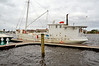 New Bern, North Carolina The Chesapeake buy boat, O.A. Bloxom, seen in New Bern, North Carolina, 5 November 2011.<br /><br />See more at:<br /><br />http://jacksonville.com/tu-online/stories/052408/met_282310730.shtml<br /><br />and from national Fisherman:<br /><br />Small marine railways that serve commercial fishermen are scattered up and down the southern portion of the United States. They are an important part of the infrastructure that keeps fishing boats afloat and the business of catching fish alive.<br /><br />Linton Marine Railway in Valona, Ga., is a good example. It is at the end of an old dirt road that leads down to shrimp boat docks. With a single railway, Linton caters to the longtime shrimping fleet that works out of Valona and other small fishing villages on the Georgia coast.<br /><br />Matt Linton, who owns and operates Linton Marine Railway, says his main customers are commercial fishermen. ?Mainly all we work on are commercial fishing boats or fishing boats that have taken on a new life,? he says. ?We are mostly a wooden-boat boatyard.?<br /><br />One older commercial fishing boat that has taken on a new life was on the railway in March getting its wooden hull covered with fiberglass.<br /><br />The O.A. Bloxom was built in 1901 and originally named the Nora Phillips. J.T. Marsh built the 75' x 21' O.A. Bloxom at his boatyard at Solomons, Md. The boat is historically significant because it is one of just a few Chesapeake Bay bugeyes still afloat.<br /><br />In the late 1800s and early 1900s, these sail-powered boats were used to dredge for oysters, serve as buyboats and haul freight on the bay. Most were built out of logs instead of planks. However, the O.A. Bloxom was built with planks ? pine planks, 3 inches thick. After being converted to power, the O.A. Bloxom worked Chesapeake Bay until 1991, when she went south to carry freight from Ft. Lauderdale, Fla., to the Caribbean.<br /><br />Ritch McCormack of Fernandina Beach, Fla., the boat?s owner, says, ?When we sandblasted to remove all the paint below the waterline, the entire boatyard smelled like fresh-cut heart pine.<br /><br />?Some people say fiberglassing the bottom is like putting a coffin on a wooden boat. Well, I say those old iron fasteners that weeped rust out onto the hull so proficiently will forever be denied the opportunity to detract from the appearance of the Bloxom.?<br /><br />The boat also got new wooden cap rails and rub rails, four berths were installed in the main hold, the heads were upgraded and a new shower was added.