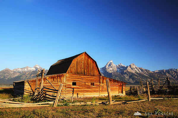 Grand Tetons with a barn from Mormon Row