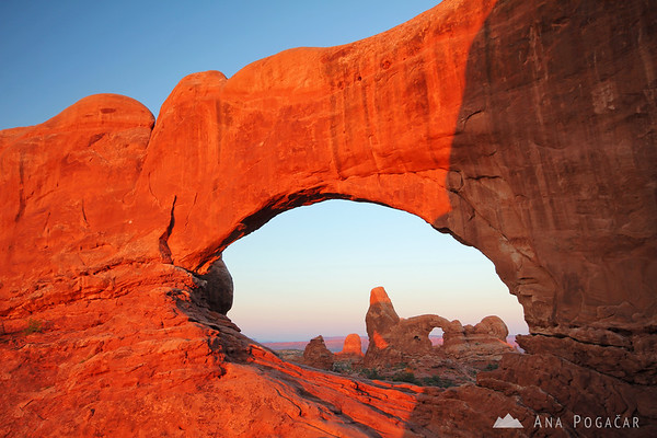 Turret Arch through the North Window Arch at sunrise, Arches NP
