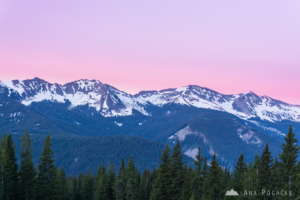 Pink sky before the sunrise above the West Elk mountains from above Lake Irwin near Crested Butte, Colorado