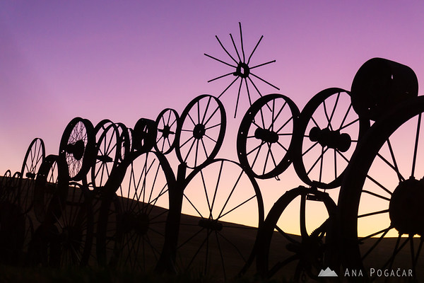 Wheel fence at the Dahmen barn in Uniontown (the Palouse) after sunset