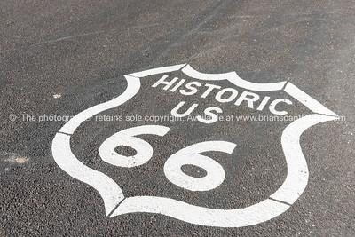 Historic US 66 sign on road, Arizona, USA.
