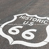 Historic US 66 sign on road, Arizona, USA.