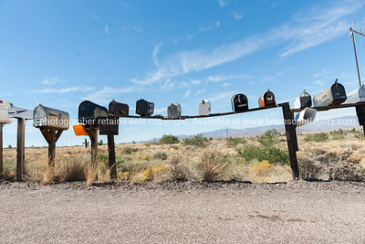 Row of letterboxes at intersection of rural road and Route 66, Arizona, USA