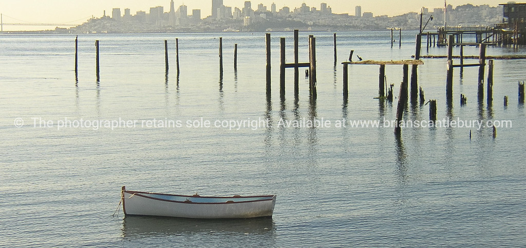 Dinghy and harbour edge, Sausalito, looking back to San Fransisco, California, USA.