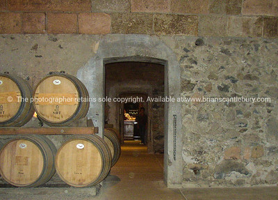 Wine cellar, barrels in entrance.