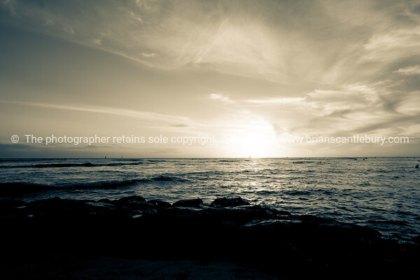 Sunset at Hawaiian beach.
