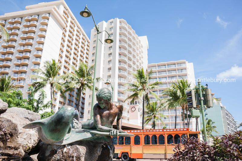 Surfer with Seal sculpture on Waikiki Beach. Waikiki, HI.