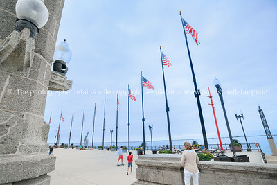 Navy Pier, Chicago. Row of flags fluttering in evening breeze as sky darkens. Illinois, USA