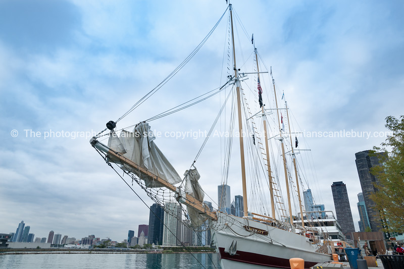 "Tall ship ""Windy"" at Navy Pier, Chicago. City skyline in background. Illinois, USA"