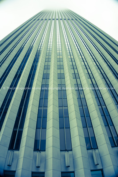 Skyscaper building with vertical leading architectural lines towering skyward