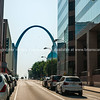 St Louis Gateway Arch at end of city street framed by high-rise buildings. St Louis, architecture, and famous arch, Missouri,USA.