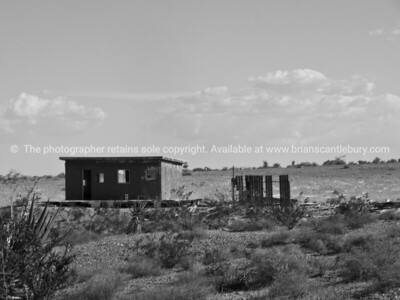 Old cabin, Red Rock Canyon, located 20 miles west of Las Vegas off State Highway 159, in black and white.