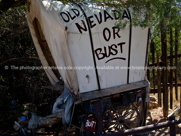 Nevada or Bust, covered wagon with classic goal at Bonnie Springs in Red Rock Canyon, Nevada, USA.