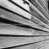 Old weathered clapboard wall in black and white.