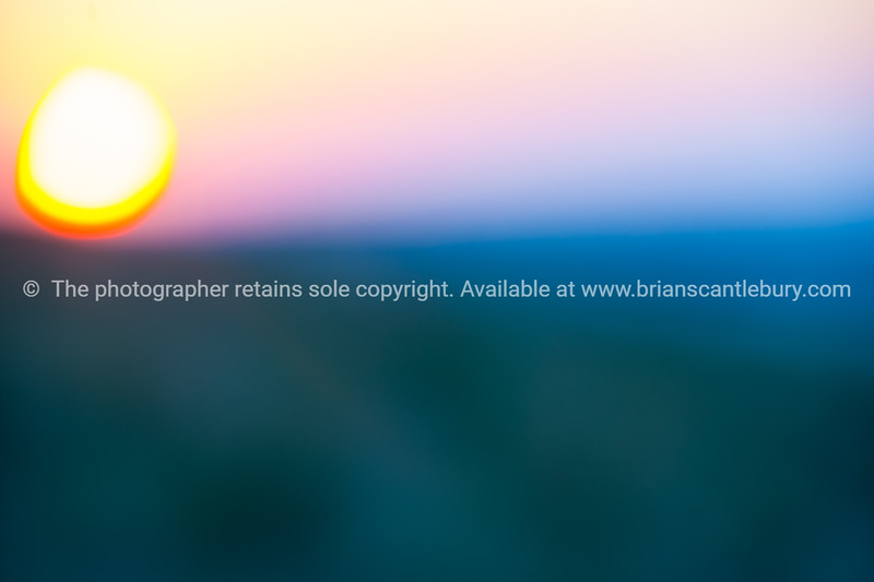 Abstract out of focus sunset background image