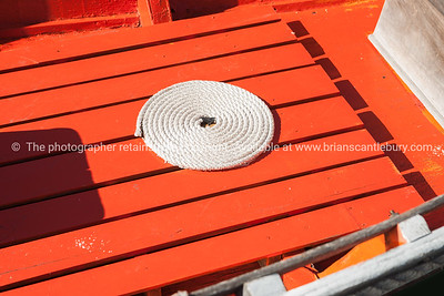 Coiled rope on floor of restored dinghy. Boothbay, Maine, USA