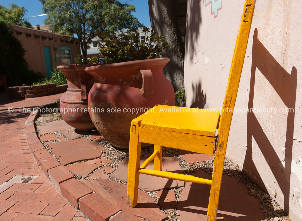 Yellow wooden chair on pation