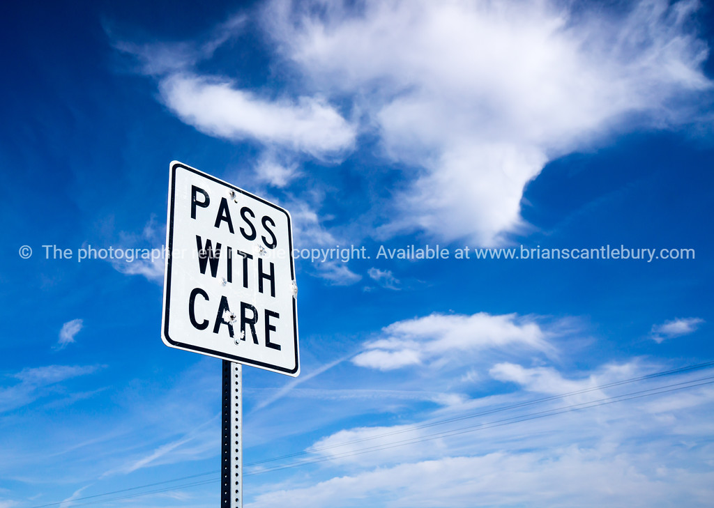 Pass with care sign.