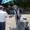 Silver man, street performer greest a passer-by.