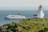 • Location - Grand Manan Island<br /> • View of the Grand Manan V Ferryboat passing by the Last Swallow Tail Lighthouse