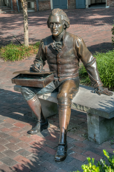 • Location - Williamsburg, VA<br /> • A bronze sculpture sitting on a downtown bench