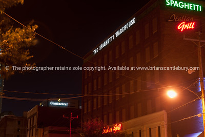 Bricktown Spaghetti Warehouse building at night illuninated signs, Oklahoma City, Oklahoma on Route 66