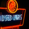 OK Used Cars retro neon sign illuminated.