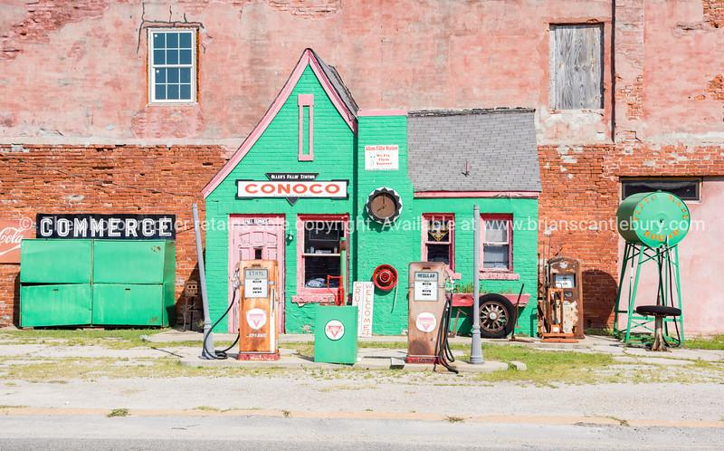 Historic green Conoco garage, Main street of Commerce, Oklahoma, USA Route 66
