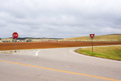 Rich red soil and agricultural land from Route 66 intersection, Oklahoma on Route 66