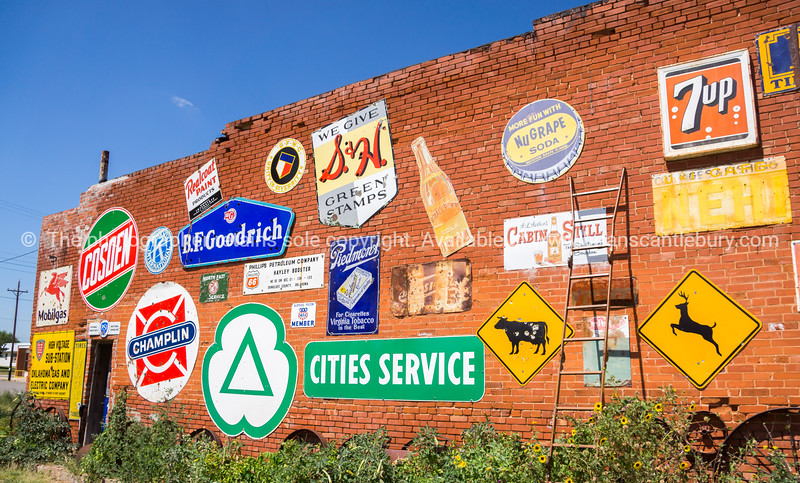 Exterior wall with old signs, Sandhills Curiousity Shop, Erick, Oklahoma, USA.