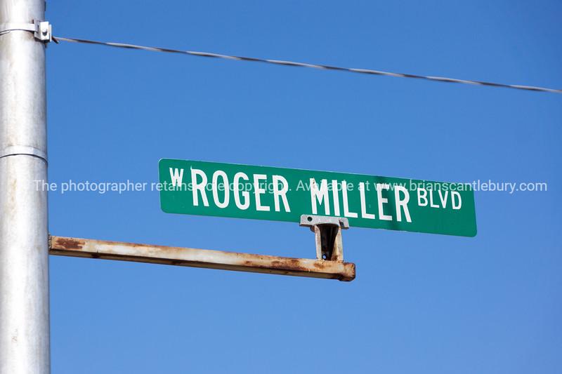 Roger Miller Boulevard street sign in Erick, Oklahoma, USA
