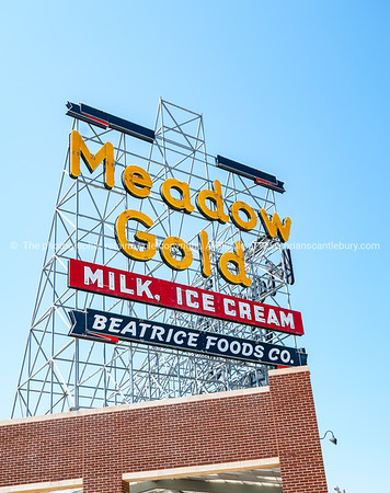 Restored Meadow Gold neon on corner 11th Street and Quaker Ave, buidlings and street scenes Tulsa, Oklahoma on Route 66.
