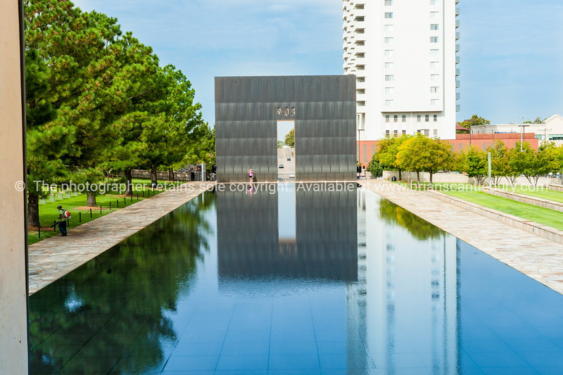 Oklahoma City Bombing Memorial Gate of Time with time of bombing at 9:03 in 1997.