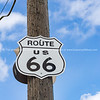 Route US 66 highway sign on power pole Route 66 USA.  one of the incredible variety of 66 signs seen along the historic route.
